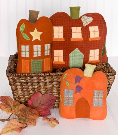 """Our """"Spice Town"""" pattern includes 3 pumpkin house pillows designed for fall decorating. 6"""" x 10"""", 7"""" x 8"""" and 9"""" x 10"""". Group in a basket, on a table, or surround them with real pumpkins. Fall decorating will be fun! Wool applique by machine or hand"""