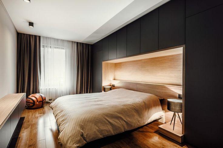 dormitorio moderno con lamparas doradas