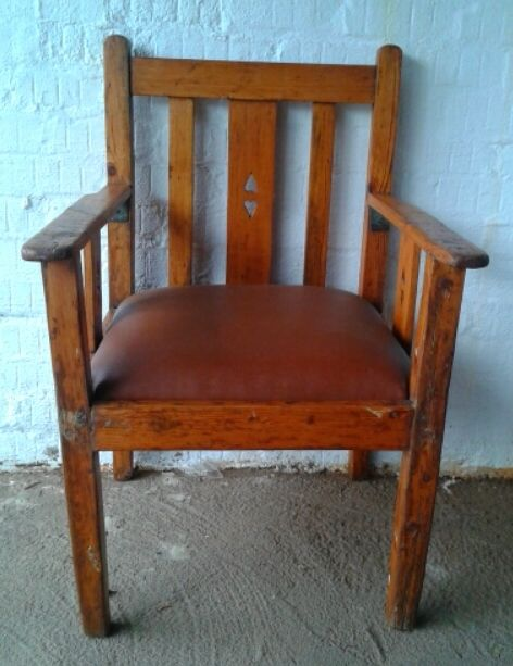 #NorthcliffAntiques Arts and crafts Morris armchair. Wood: Oregon Pine. Finish: Varnish. Details: Has a drop-in upholstered faux leather seat. #Chairs #Armchair #Furniture #Wood #Antiques #Johannesburg