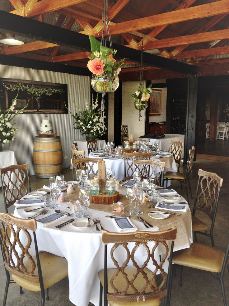 The Function room with burlap runners and hanging floral baskets at Yarra Ranges Estate. Winery Wedding   Yarra Valley Wedding   Dandenong Ranges Wedding