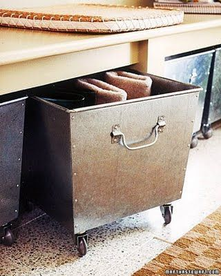 Storage bins with casters to slide under a bench.