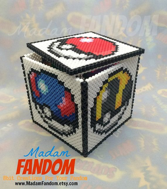 Pokemon box from MadamFANDOM. Each side features a different Pokeball and on the inside, you'll see a little sleeping Pikachu, curled up and looking adorable :D. *This pixel/bead box was designed & created by #MadamFANDOM *