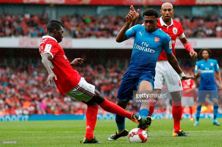 Arsenal's Nigerian striker Alex Iwobi vies with Benfica's Portuguese defender Aurelio Buta (L) during the pre-season friendly football match between Arsenal and Benfica at The Emirates Stadium in north London on July 29, 2017, the game is one of four matches played over two days for the Emirates Cup. / AFP PHOTO / Ian KINGTON / RESTRICTED TO EDITORIAL USE. No use with unauthorized audio, video, data, fixture lists, club/league logos or 'live' services. Online in-match use limited to 75…