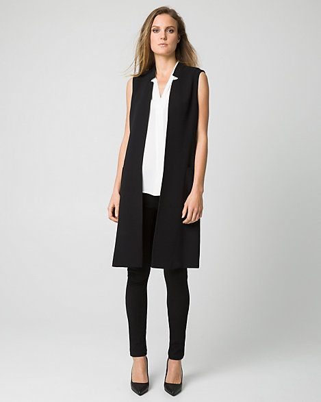 e love the tailored feel of this statement-making long vest designed with an inverted collar for a chic finish.