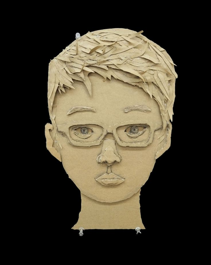 16 Cardboard Portraits by 12th Graders.