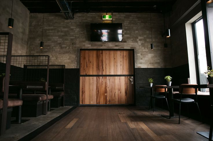Northcote Social Club renovation by Breathe Architecture @breathearch - Melbourne Architects. It features the timber stylings of yours truly on the bar, bench seating, table tops, and this big timber / steel door. We hope you enjoy it as much as we enjoyed working on the project.  📷 Kane -Roam'n Images.