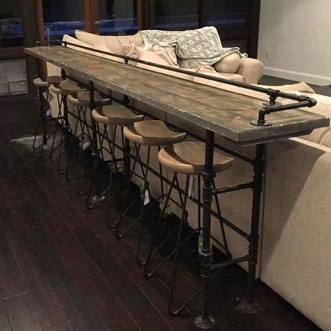 I am seriously in love!  Bar for behind the chairs in the media room.  Bar from wood and pipes.  Wonderful DIY bar!