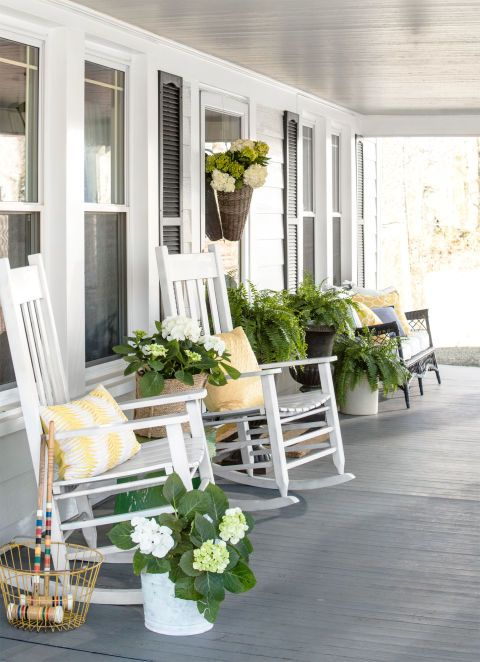 Really praying our retirement house will have a lovely porch to relax on. Love the gray floor and white furniture: