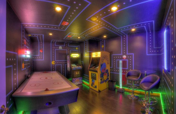 Eclectic Game Room with Wall sconce, Hardwood floors, High ceiling