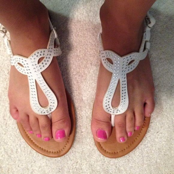 !!!!!Sandals gems white!!!!!!! Sandals silver gems white. Never been worn. Gem fell off from shuffling around. but not noticeable Too big on me but super cute. FINAL PRICE NO OFFERS! Gordman's Shoes Sandals