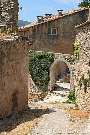 The village of Bonnieux ~ is perched on a narrow, steep ridge, rising up from a flat plan above the valley. Regarded as one of the finest villages in the south of France