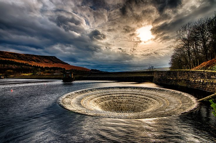 Ladybower bellmouth spillway with dramatic skies