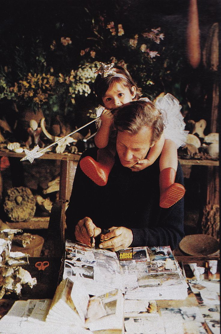 Peter Beard working on his diaries with his daugher Zara. Photography by Alexandre Bailhache