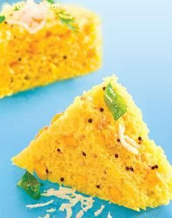 This version of corn and maize flour dhokla turns out well in the microwave provided you mix the batter well and add the fruit salt right in the end. Enjoy these hot, with chutneys of your choice. And do not forget the coriander and coconut garnish as any dhokla would be incomplete without it!