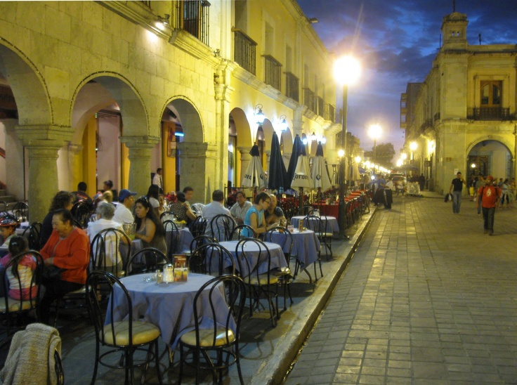 The Zocola in Oaxaca.  Wandering musicians provide music until late hours.  People eating....fantastic food!---strolling, and dancing.