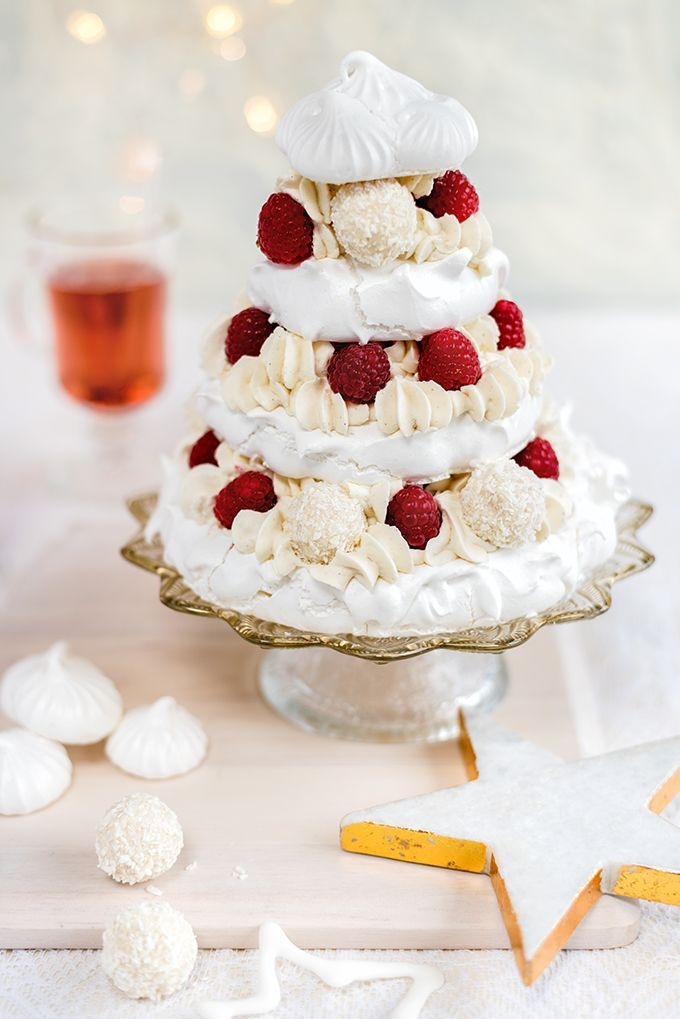 Meringue Christmas tree with whipped coconut cream, raspberries and white chocolate truffles – a spectacular festive dessert!