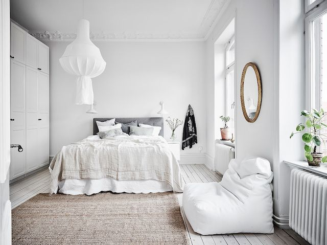 Bedroom in a magnificent white Swedish apartment