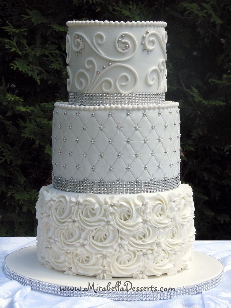 3-tier white wedding cake with silver pearls and diamante trim