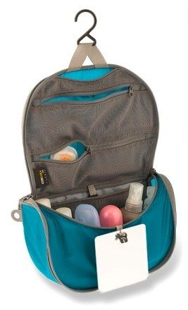 Sea to Summit Travelling Light Hanging Toiletry Bag - Small (I have the small large, and they are Feather lite and pretty durable, but don't have stretch for when it gets too bulky, and they lack the structure I want for long-term travel so I can see my stuff. They really need to be hung and not all accomodations allow for hanging, so I'm back to light, cheap, clear plastic travel bags available at Walmart and on Amazon. (WM)