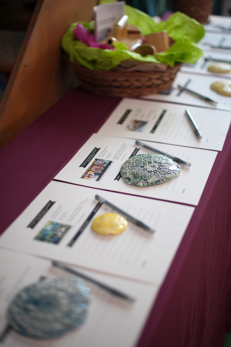 fancy rocks to hold down the silent auction bidding sheets great idea