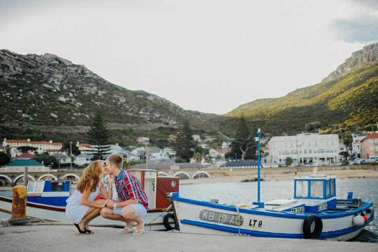 engagment session kalk bay. Colourful boats for background
