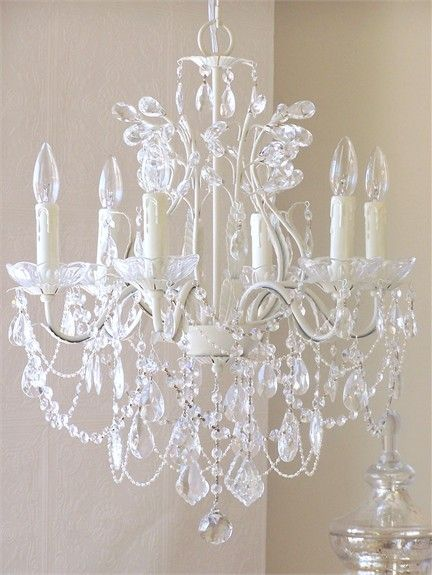 The 6 Light Leafy Antique White Crystal Chandelier is simply exquisite. Dripping with layers of crystal swags, fancy-cut French pendants and a mixture sparkling glass bobeches and crystal teardrop prisms, this antique white chandelier is a sure sign of opulence