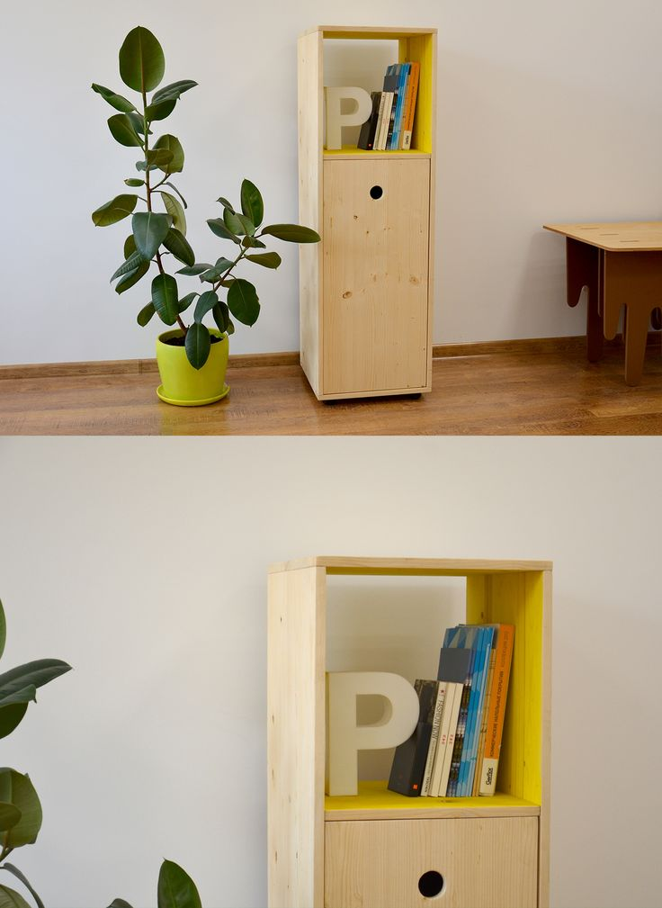 Cupboard made from pine with yellow painting inside.