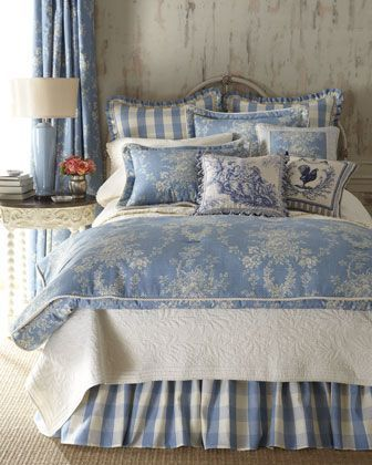 French country bedroom decorated in blue & cream with toile bedding and needlepoint