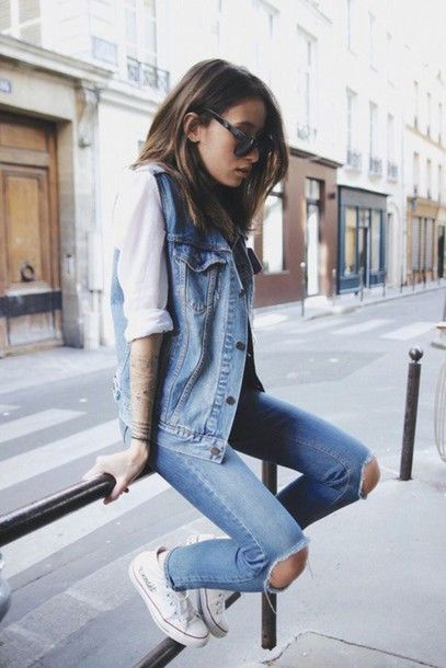 Go For Double Denim This Summer In A Sleeveless Denim Gillet Jacket And Dark Blue Denim Ripped Frayed Jeans Teamed With Low Top White Converse Sneakers Wheretoget's Hot List