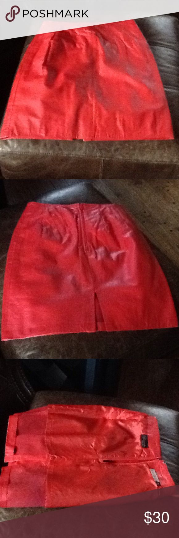 Sz5/6 red leather mini skirt. Worn once VINTAGE! Sz 5/6 red leather mini skirt never worn beautiful vibrant red, with a slit in the back and back mid zipper, too small for me😂 pia rucci Skirts Mini