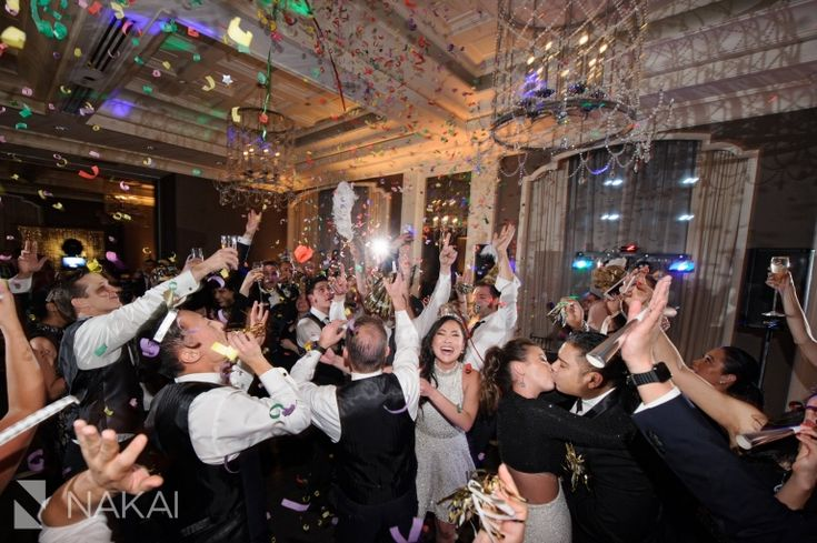 Photos of the confetti at a New Years Eve wedding celebration at the Waldorf Astoria Chicago Hotel! Love a NYE countdown at a wedding! One of the best luxury wedding venues in Chicago for photos! Top creative partners: Vale of Enna, Clementine Custom Events, Inbal Dror from Dimitras Bridal Couture. Pictures by Chicago Wedding Photographer: Nakai Photography http://www.nakaiphotography.com