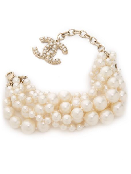 Chanel 6 Strand Imitation Pearl Bracelet .  From the 2014 collection. A previously owned Chanel bracelet composed of 6 strands of imitation pearls in variegated sizes. A gold-plated logo charm hangs from the back. Adjustable length and lobster-claw clasp. Gold plate. Made in France. Buy now http://rstyle.me/~7zuJV