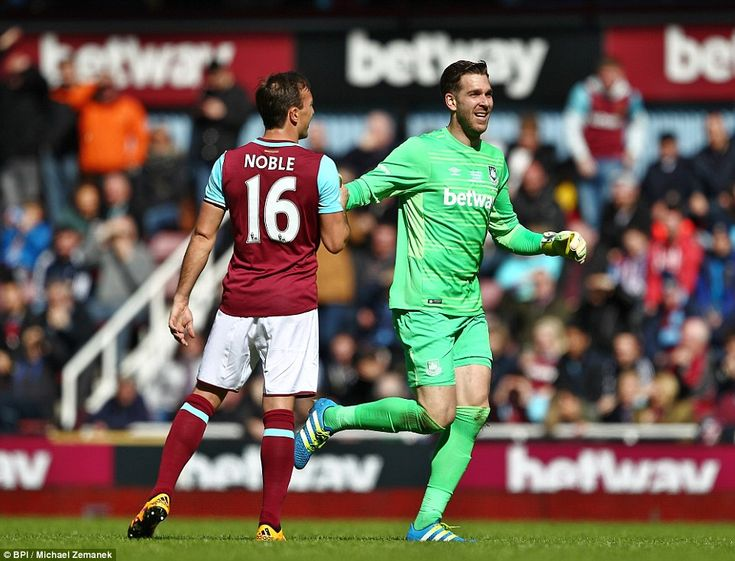 Goalkeeper Adrian (right) is congratulated on scoring by man of the hour Noble following a...
