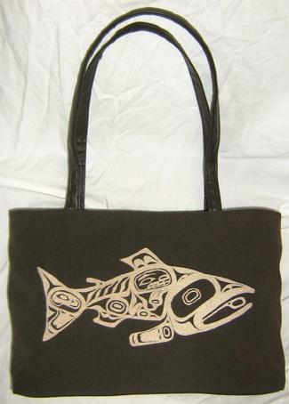 Haida Salmon/Human Being on Brown Upholstery Fabric HandBag. $225.00