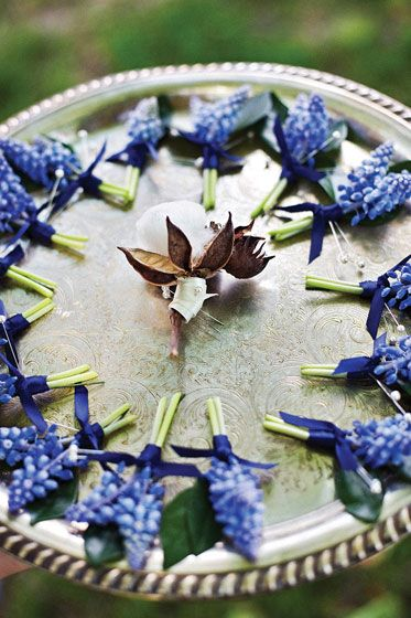 Such adorable boutonnieres! This would be perfect for a spring wedding, and grape hyacinth smells delightful.