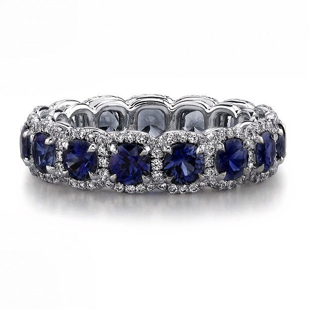 front view: Sapphire and diamond platinum eternity wedding band handcrafted with 3.51 carats of round sapphires and 0.58 carats of brilliant diamond rounds.