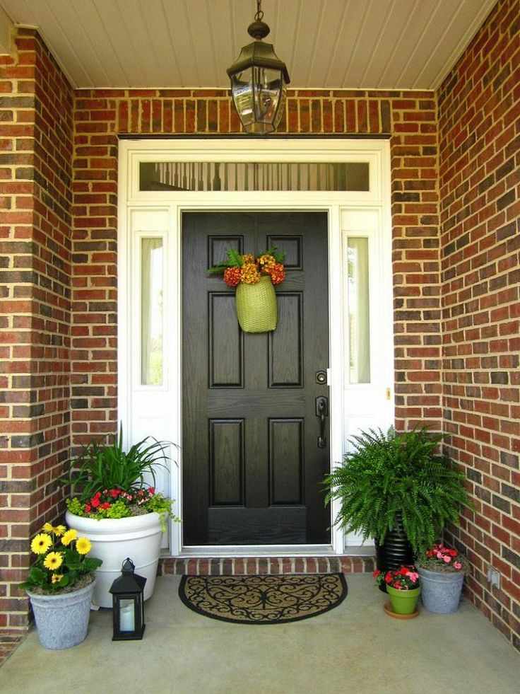 Small porch? Add plants, accessories, and a wreath on the door for a welcoming.