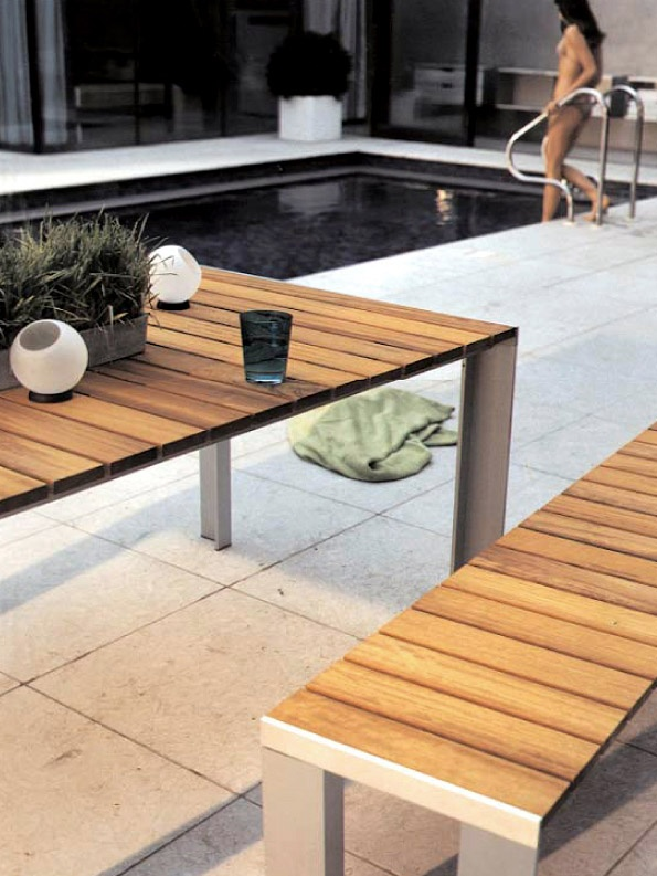 Deneb table and bench with teak top. Produced by STUA. This is a Jesus Gasca design.