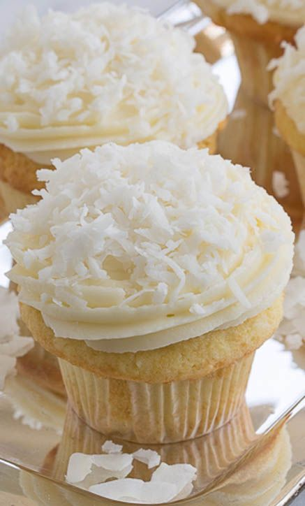 Coconut Cupcakes with Cream Cheese Frosting // LOOVE Coconut, def gona try these! <3