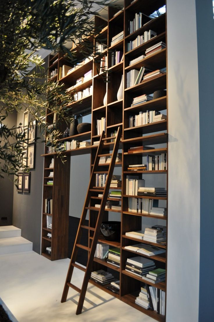 Perfect library shelving...and the brown stain and blue walls look gorgeous together.