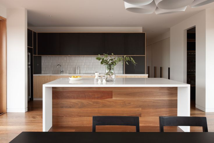 Timber kickboard and black cabinetry The palate is good...thinking about that colour palate!