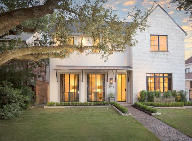 Gorgeous new build deep in the heart of Texas French doors line front no shutters for cleaner look with the stucco and brick a delight not too modern but the new traditional