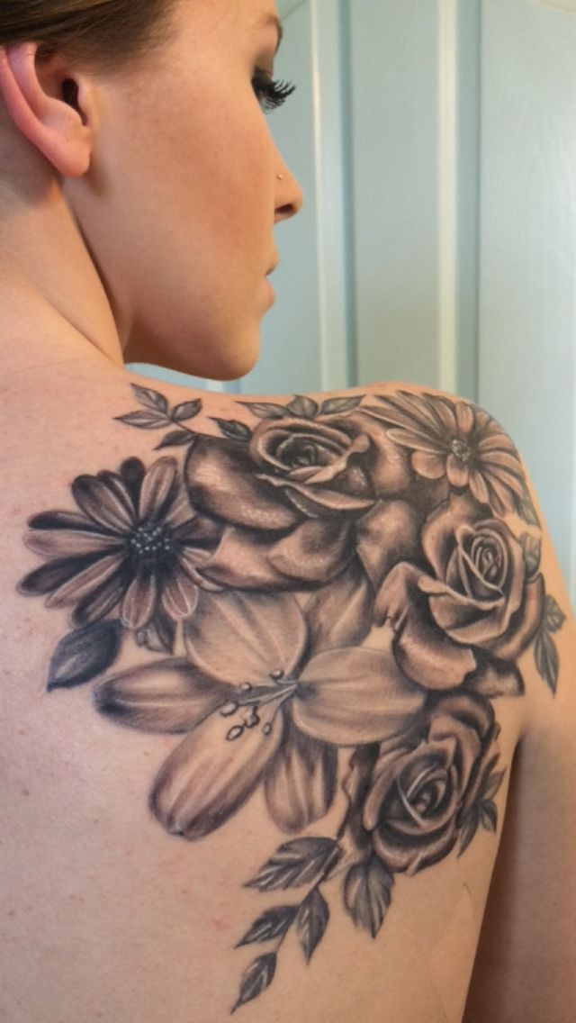 Black And Grey Daisy Flowers And Roses Tattoo On Girl Right Back Shoulder