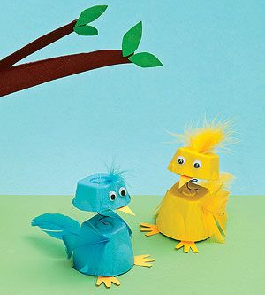 Bobble-headed birdies made from egg cartons.