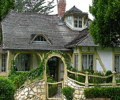 love the stone fence and arbor gate !