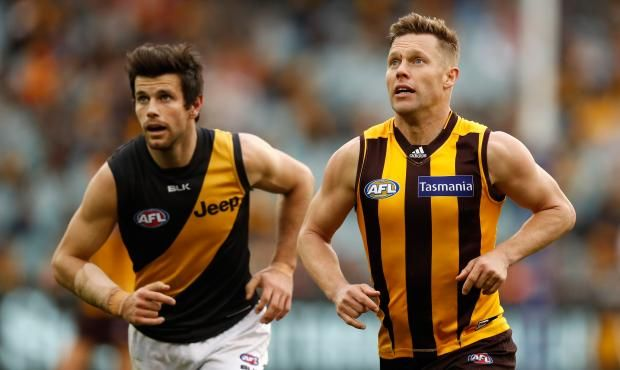 Trent Cotchin and Sam Mitchell have been awarded the 2012 Brownlow Medal.