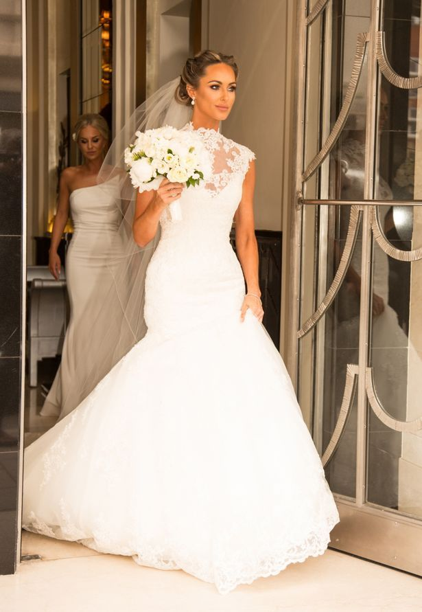 White, lace, fishtail dress with hait up and a beautiful long veil and train for TOWIE star Georgina Dorsett. All her bridesmaids were in white too.