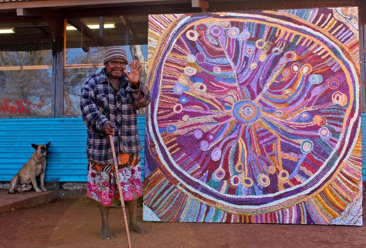 Tjala artist, Wawiriya Burton with her painting 'Ngayuku Ngura – My Country'.