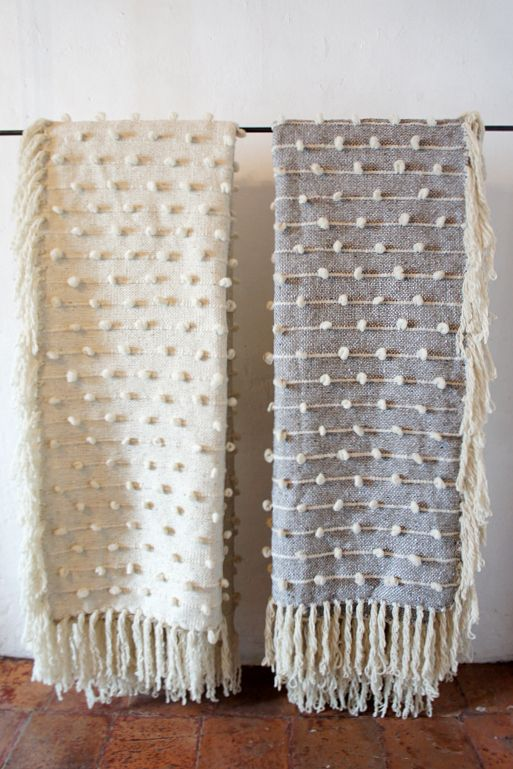 This exquisite blanket is hand woven in Central Mexico by the same master artisans who weave our fabulously plush 'Palomita' rugs. It is a mix of wool and cotton, so although it is huge in size, it is light in weight. A beautiful addition to any space which will lighten up the mood with it's playful and cozy design.Material: Sheep's Wool woven with a base of cottonCare: Dry clean or hand wash cold, line drySize: Queen 77 inches x 149 inches with 8.5 inche...