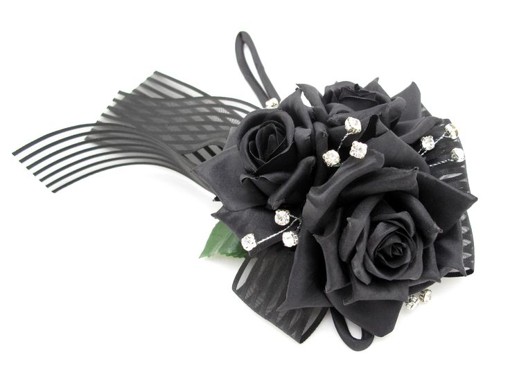 A sparkly wristlet of black roses and diamantes. Find your perfect wedding flowers at http://www.loveflowers.com.au